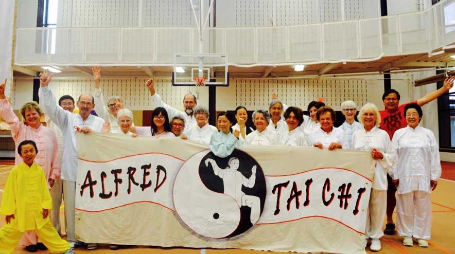 Alfred Tai Chi class with their banner